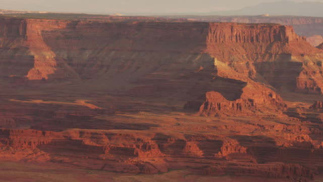 pan right, scenic moab canyon landscape - sandstone stock videos & royalty-free footage