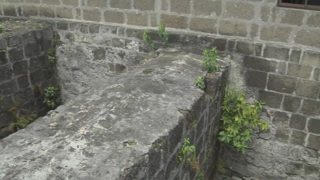 pan right shot dungeon santiago fort manila metro manila philippines  - dungeon stock videos & royalty-free footage