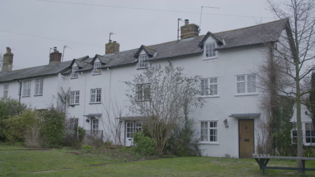 pan right shot of a row house in ashwell - bush stock videos & royalty-free footage