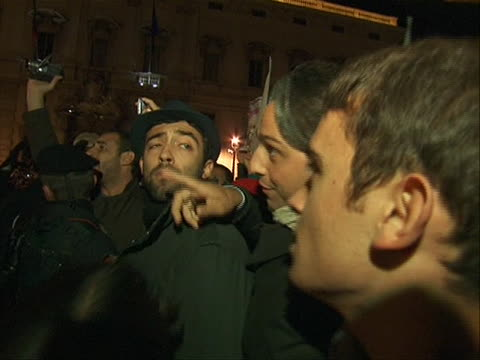 pan right shot of police facing off with citizens celebrating the resignation of prime minister silvio berlusconi he stepped down after failing to... - business or economy or employment and labor or financial market or finance or agriculture video stock e b–roll