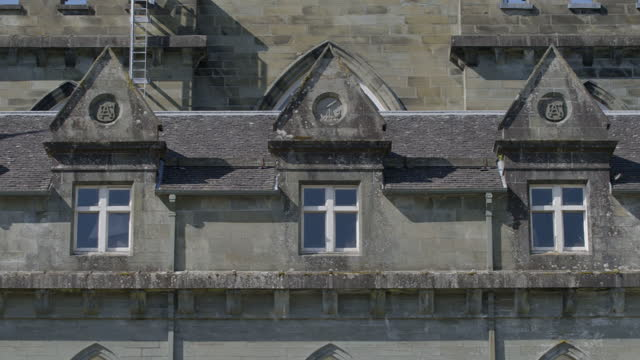 pan right shot of the dormer windows of inveraray castle - stone object stock videos & royalty-free footage
