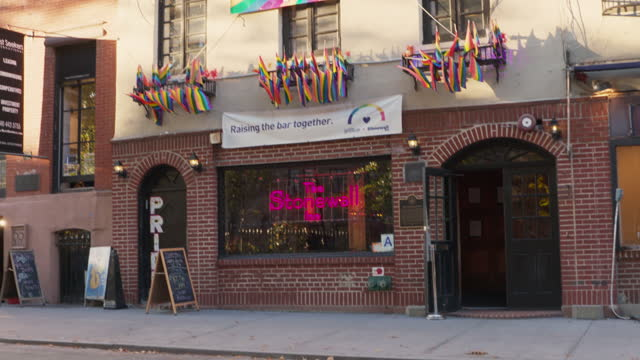 pan right shot of the entrance of stonewall inn - 1969 stock videos & royalty-free footage