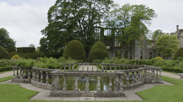 pan right shot of the fountain in the queens garden at sudeley castle - stone object stock videos & royalty-free footage
