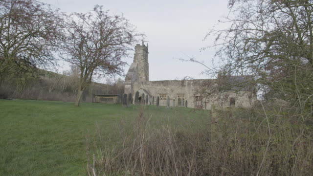 pan right shot of the ruins of st martins church in wharram percy in the deserted medieval village - tomb stock videos & royalty-free footage