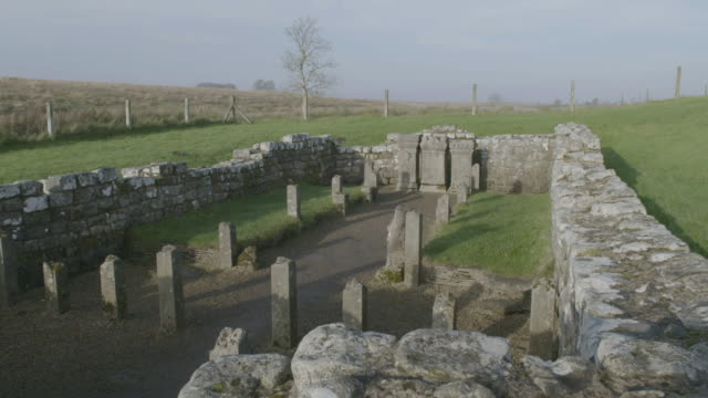 pan right shot of the ruins of the temple of mithras at carrawburgh fort - boundary stock videos & royalty-free footage