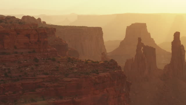Pan right, sunrise over Arches National Park landscape