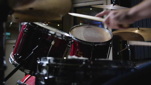pan right to a drum kit being played in a recording studio - drum kit stock videos & royalty-free footage