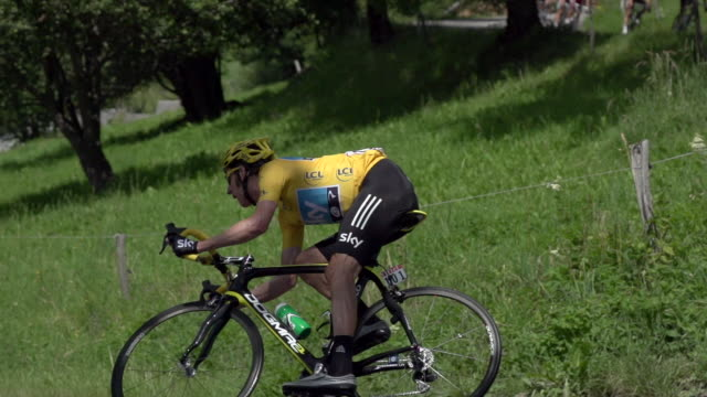pan right to left as bradley wiggins descends hairpin curve on stage 11 of the 2012 tour de france - curve stock videos & royalty-free footage