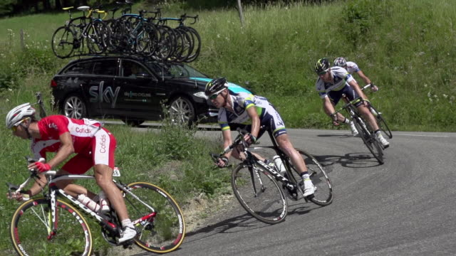 pan right to left as riders descend hairpin curve on stage 11 of the 2012 tour de france - hair accessory stock videos and b-roll footage