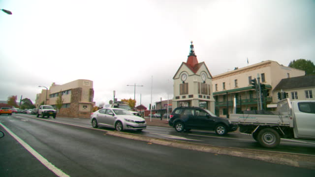 pan right to left bowral road mittagong traffic intersection including the old bank building war memorial historical society building passing traffic... - main tower stock videos and b-roll footage