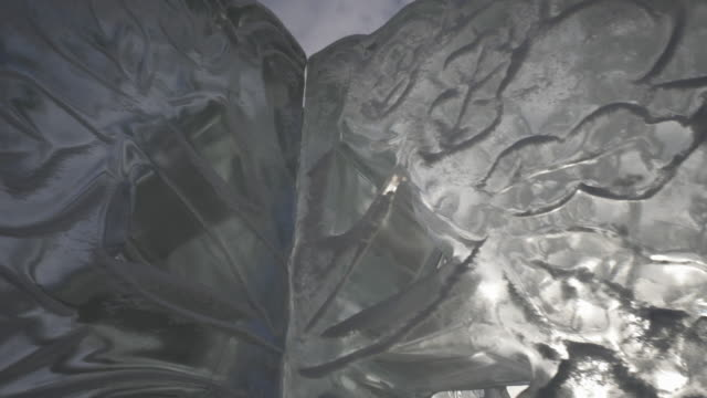 pan right to left close-up: looking closely on the ice sculpture's design with crystal like features - krasnoyarsk, russia - ice crystal stock videos and b-roll footage