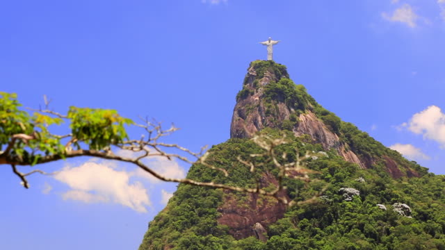 Pan Right to Left: Cristo Redeemer on Mountain