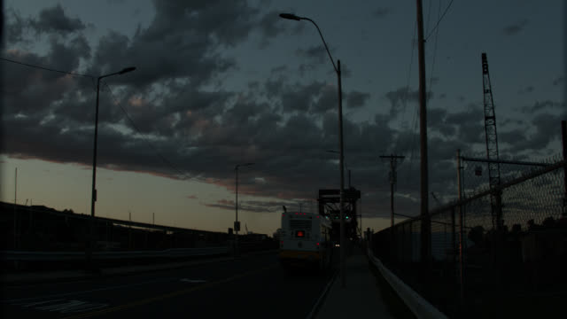 pan right to left from andrew mcardle, meridian st. bridge to sunset and maurice j. tobin bridge over mystic river. construction cranes. drawbridge. - drawbridge stock videos and b-roll footage