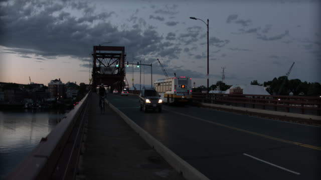 pan right to left from andrew mcardle, meridian st. bridge to sunset and maurice j. tobin bridge over mystic river. boats in fg. drawbridge. - drawbridge stock videos and b-roll footage