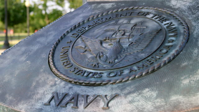 pan right to left: logo of the american navy (shot on red) - navy stock videos & royalty-free footage