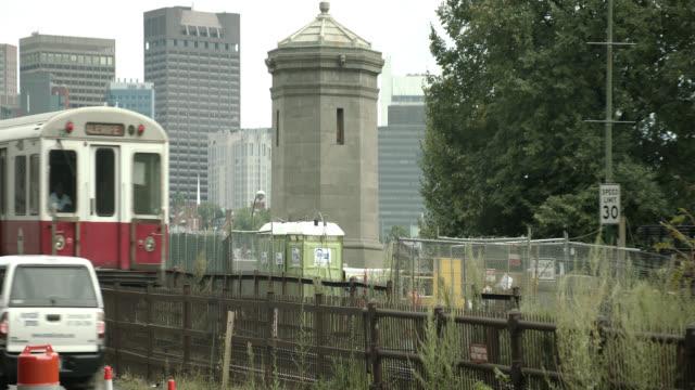 pan right to left of metro train. high rises and skyscrapers in boston city skyline in bg. longfellow bridge.