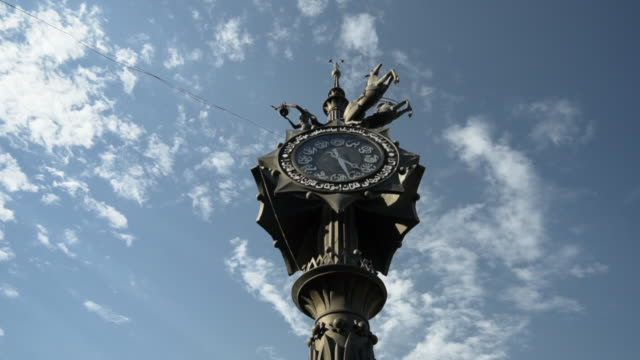 pan right to left: steel clock with statues on top of the object - kazan, russia - kazan russia stock videos and b-roll footage
