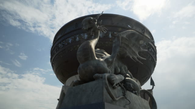 pan right to left: weird statue serpent looking fiercely under the sun - kazan, russia - kazan russia stock videos and b-roll footage