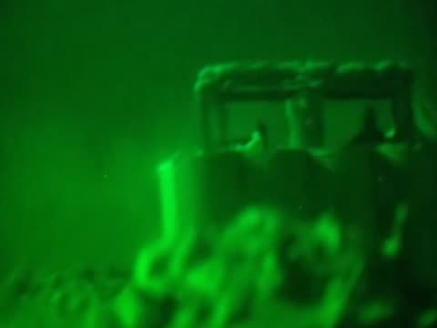 pan right to soldiers firing guns during conflict in afghanistan at night - 2001年~ アフガニスタン紛争点の映像素材/bロール