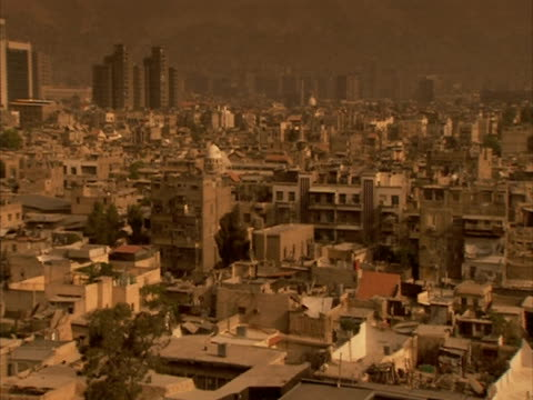 Pan right to WA view of Damascus from Umayyad mosque, Syria (sound available)