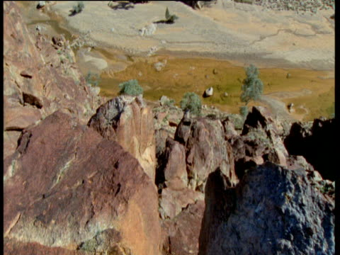 pan right viewing down from rocky outcrop, flinders range, australia - outcrop stock videos & royalty-free footage