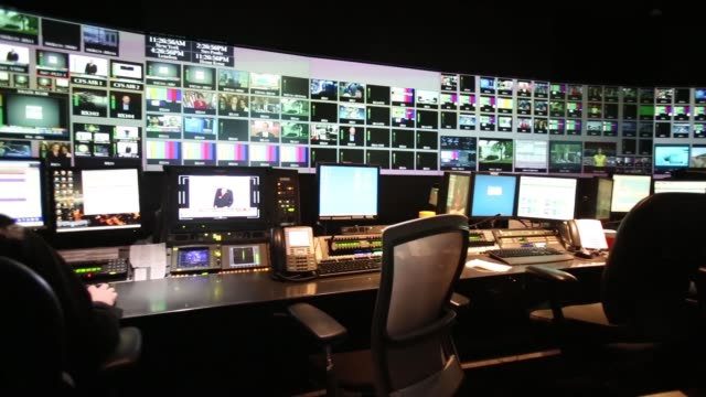 pan r-l broadcast operators monitor news input and output in the production control room at the bloomberg television studios in new york, back view a... - control room stock videos & royalty-free footage