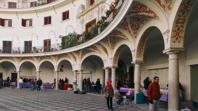 Pan RL of antiques market at Plaza del Cabildo, Seville, Spain