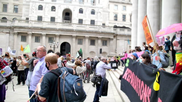 pan round large protest extinction rebellion protest london 2020 out side the bank of england with drummers and colourful flags - campaigner stock videos & royalty-free footage
