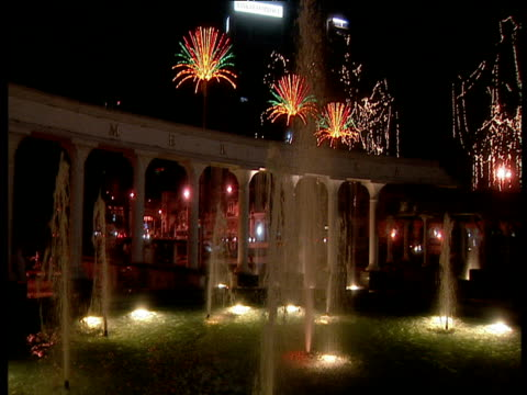 pan round merdeka square kuala lumpur with fountains illuminated at night and other illuminations in background - merdeka square kuala lumpur stock videos & royalty-free footage