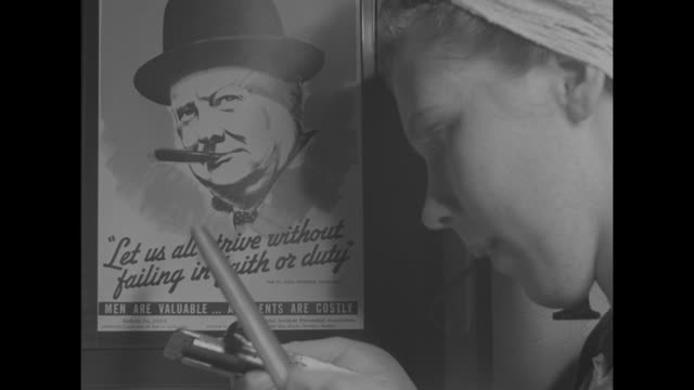 pan row of young women hair tied up in bandanas holding hand tools including wrenches files / woman files pipe in front of poster of winston... - poster stock videos and b-roll footage