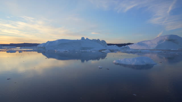pan: scenic view of disko bay against sky during sunset - inlet stock videos & royalty-free footage