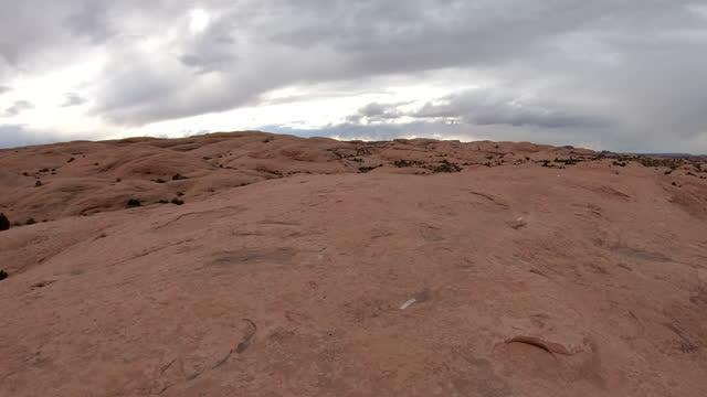 pan scenic view of slickrock trail, moab, utah - moab utah stock videos & royalty-free footage