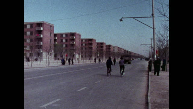 pan shanghai street with bicycles and apartment blocks; 1973 - maoism stock videos & royalty-free footage