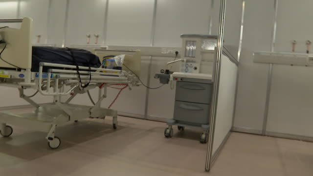 pan shot along empty beds in the newly built nhs nightingale hospital at the excel centre a field hospital built to help with demand during... - panning stock videos & royalty-free footage