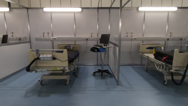 pan shot along empty beds inside the nhs nightingale, at the excel centre, a field hospital built to cope with demand from the coronavirus crisis - temporary stock videos & royalty-free footage