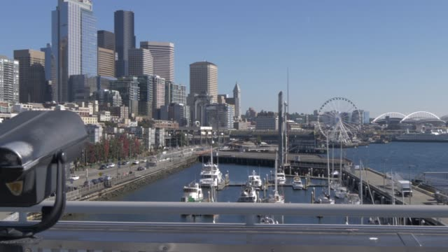 pan shot from elliott bay to seattle downtown, including seattle wheel and waterfront, seattle, washington state, united states of america, north america - elliott bay stock videos & royalty-free footage