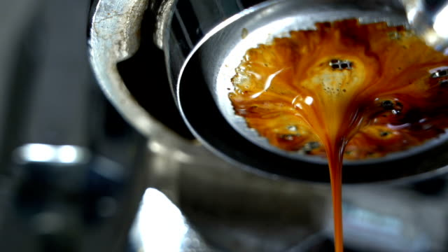 slomo pan shot making espresso coffee. - espresso stock videos & royalty-free footage