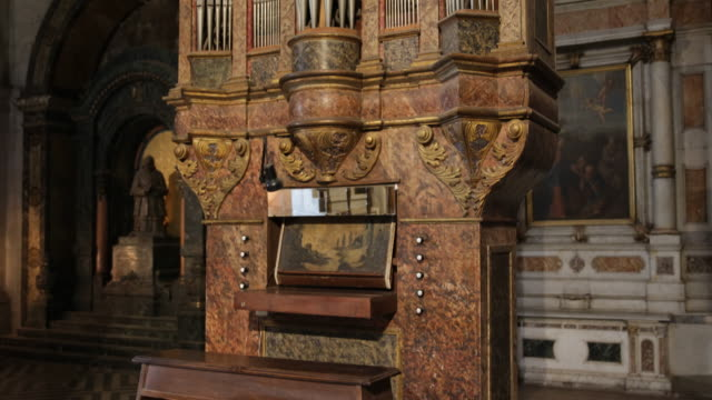 pan shot of a marble organ in the classical style with golden baroque elements in the metropolitan cathedral in santiago de chile the metropolitan... - classical style stock videos & royalty-free footage