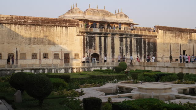Pan shot of beautiful garden in courtyard of ancient stone Fort of Amber, a UNESCO world heritage site