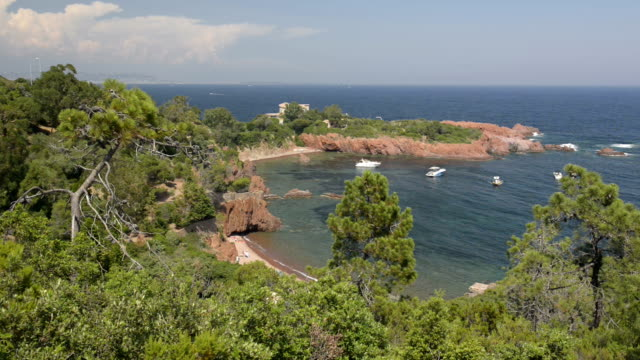 pan shot of boats in a bay at cap roux - var stock videos & royalty-free footage