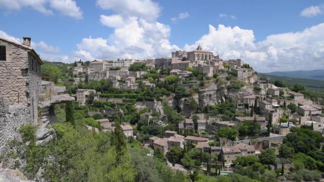 pan shot of mountain village gordes - luberon video stock e b–roll