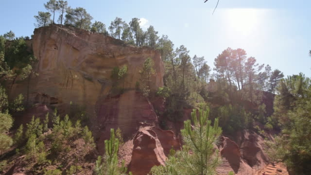 pan shot of ocre canyon of roussillon - luberon video stock e b–roll