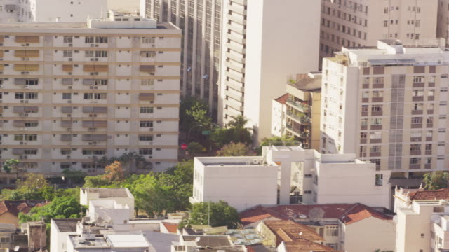 Pan shot of residential and business buildings in Rio de Janeiro, Brazil.