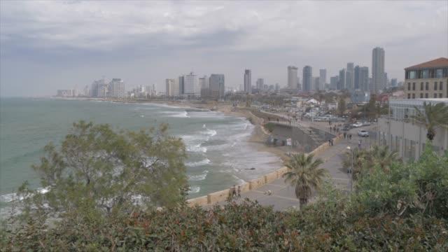 pan shot of sea and tel aviv skyline from jaffa old town, tel aviv, israel, middle east - jaffa bildbanksvideor och videomaterial från bakom kulisserna