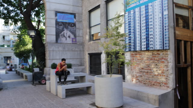 stockvideo's en b-roll-footage met pan shot of the campus with students at university alberto hurtado, in downtown santiago de chile, chile. the university is named after father... - padre