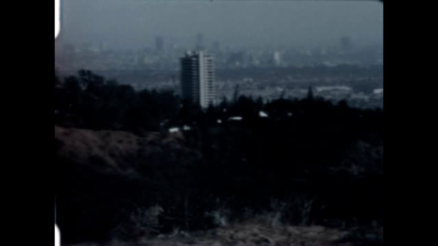 pan shot of the hollywood hills and los angeles from a home movie collection. - west hollywood stock-videos und b-roll-filmmaterial