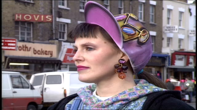 pan shot of woman's outfit in london - dungarees stock videos & royalty-free footage