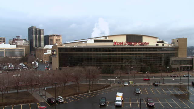 stockvideo's en b-roll-footage met a pan shot showing the xcel energy center along with other buildings of the st. paul minnesota skyline  - st. paul minnesota