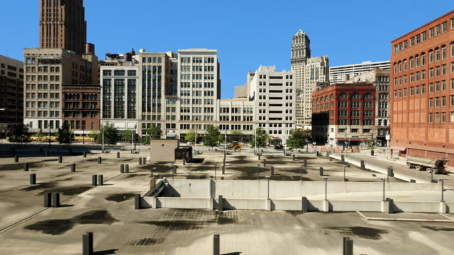 pan shot through downtown detroit. passing by woodward ave. shot from people mover - aerial stock videos & royalty-free footage