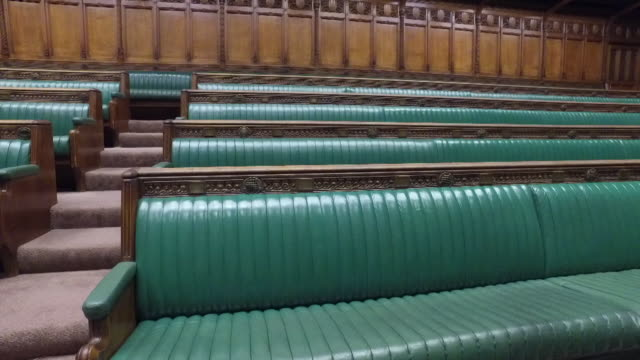 pan shots along green benches in an empty house of commons - house of commons stock videos & royalty-free footage